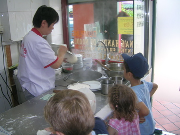 three kids in Chinese restaurant