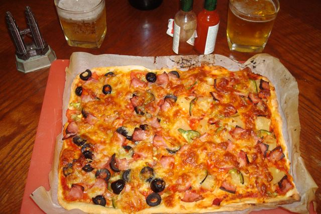 Naoko's super-pizza: half with olives (for Peter and Naoko) and one half with pineapple (for Zen)