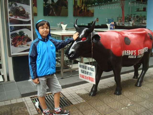 Naoko and Zen hanging out with KL cow, 2011