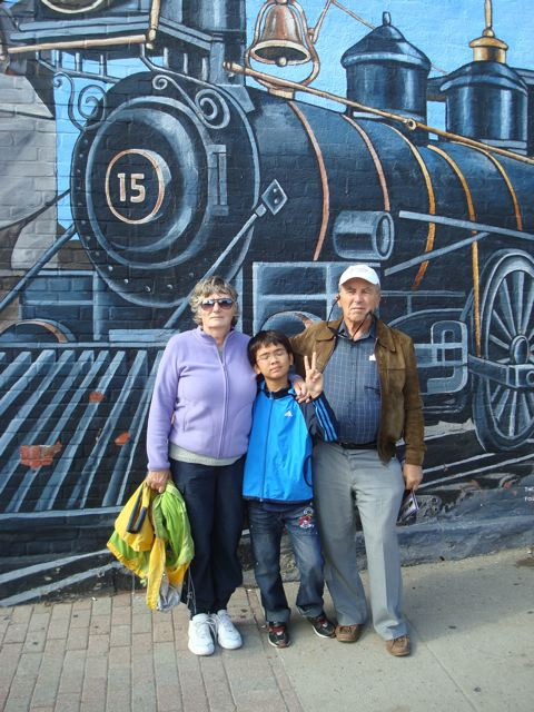 Oma, Opa and Zen in front of a downtown Midland mural