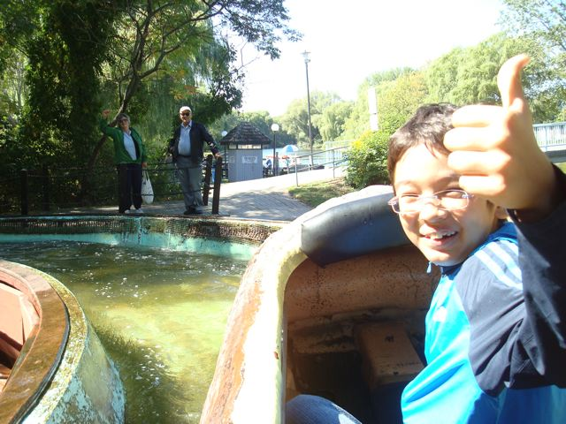 At the bottom of the Centreville Log Flume ride on Toronto Island, with Oma and Opa at left.