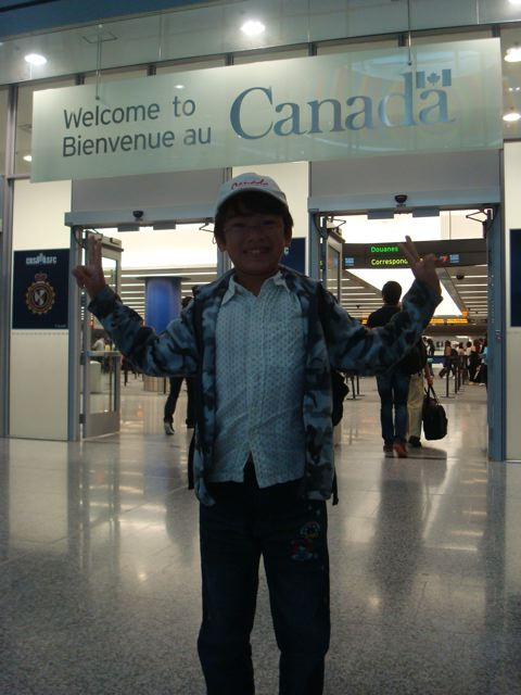 Zen arrives back in Canada (with his Canada cap on)