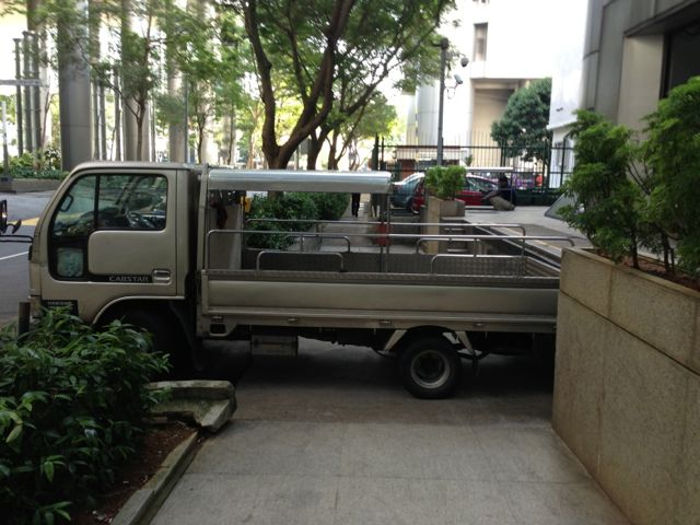 typical Singapore parking, straddling the sidewalk. Thanks, asshole.