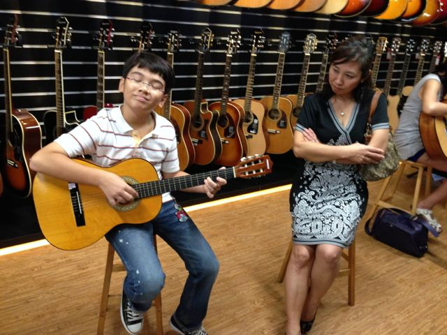 Zen pluckin' the strings at Swee Lee Music