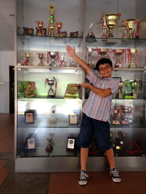 In front of Maris Stella school's softball trophy case